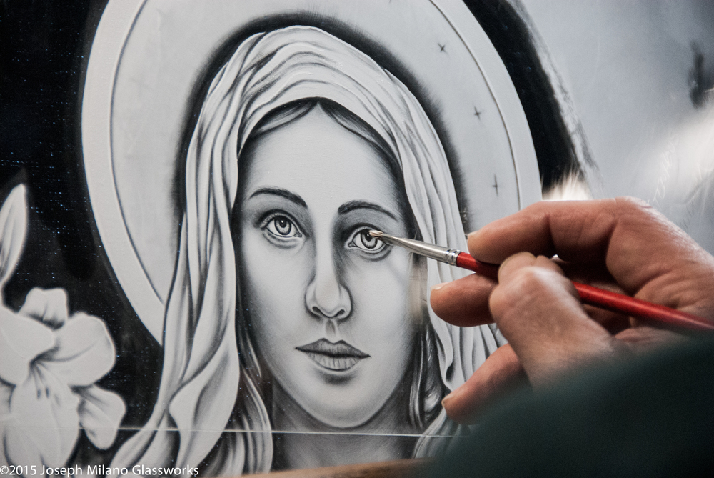 Painting detail of Mary's face.