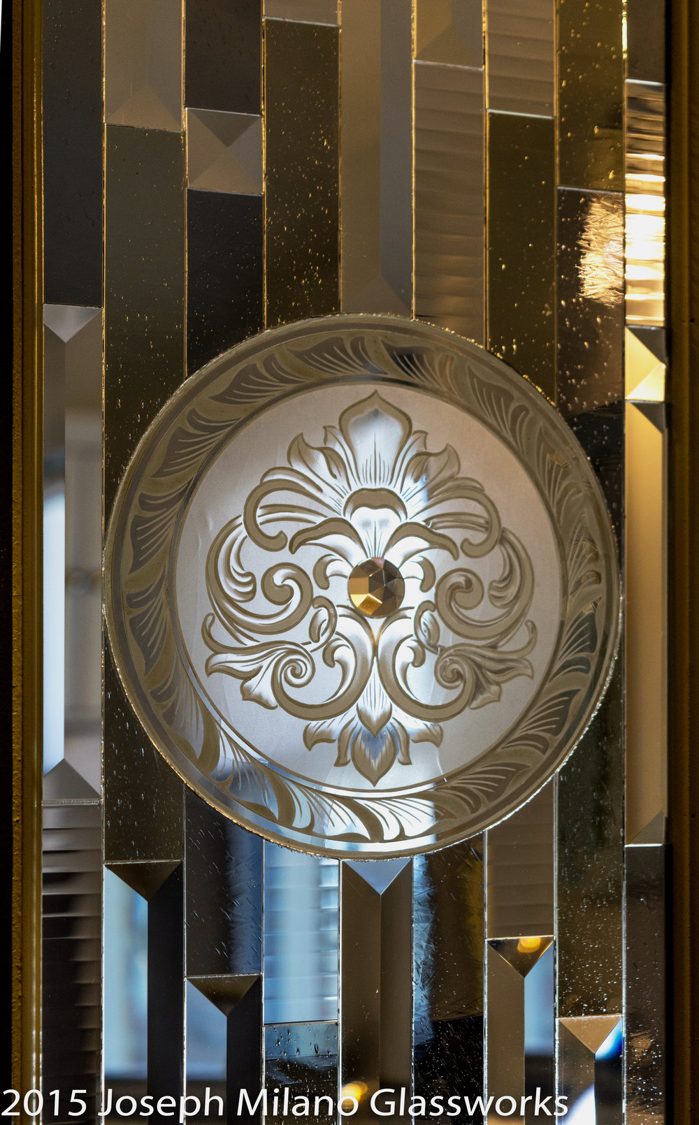 Laminated privacy glass with Milano-Ti™, titanium etched glass medallion