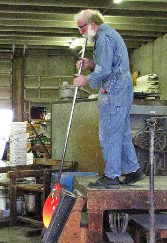 Jim Flanagan of  Fremont Antique Glass  blowing antique glass.