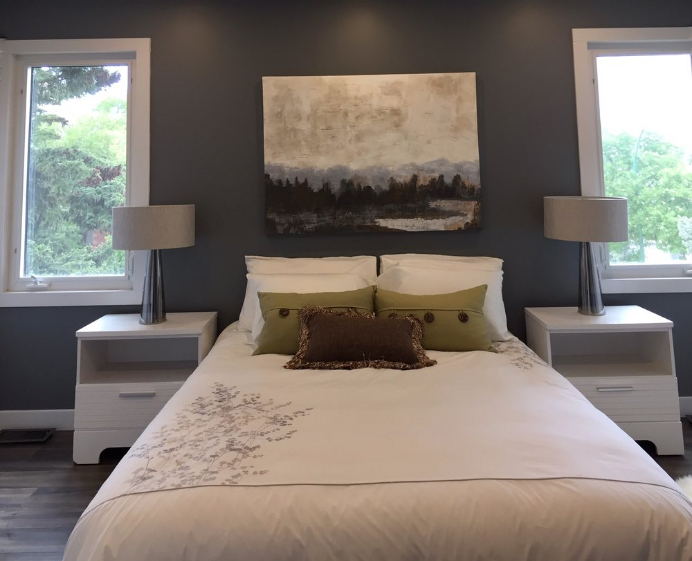 The Master Bedroom is staged with a Queen Size bed, but you can tell it could hold a King Size. I painted the Misty water picture 2 years ago. The colours go well in this room.