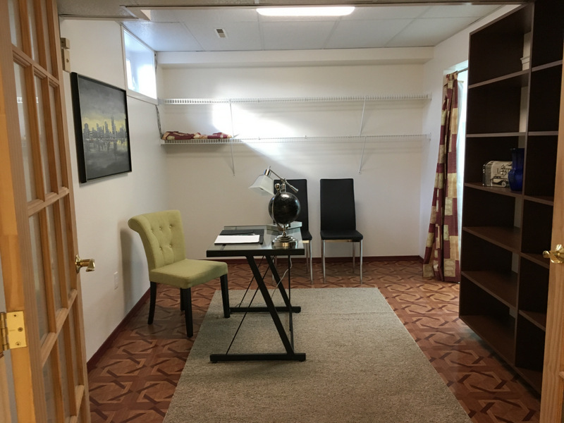 This room was shown as an office, with lots of room for more furnishings and highlights a large built in bookcase.