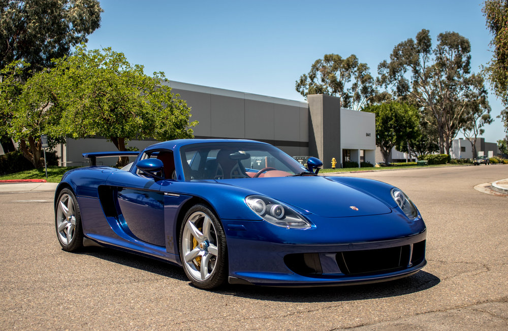 Carrera GT received full vinyl wrap in 3M's Deep Blue Metallic