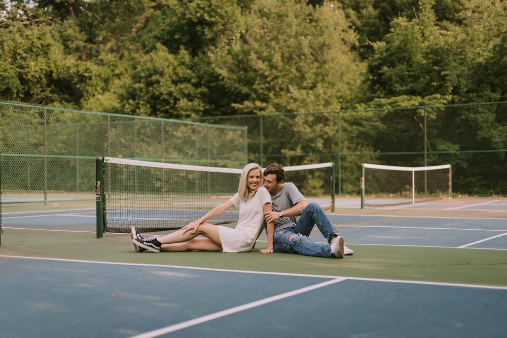 DawsonandKaileyTennisCourtEngagementsFayettevilleArkansasFreckledFoxPhotography-9302.jpg