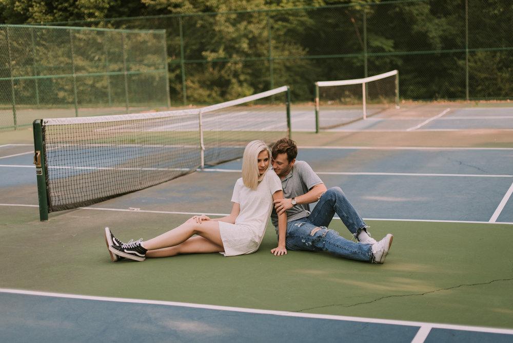 DawsonandKaileyTennisCourtEngagementsFayettevilleArkansasFreckledFoxPhotography-9327.jpg