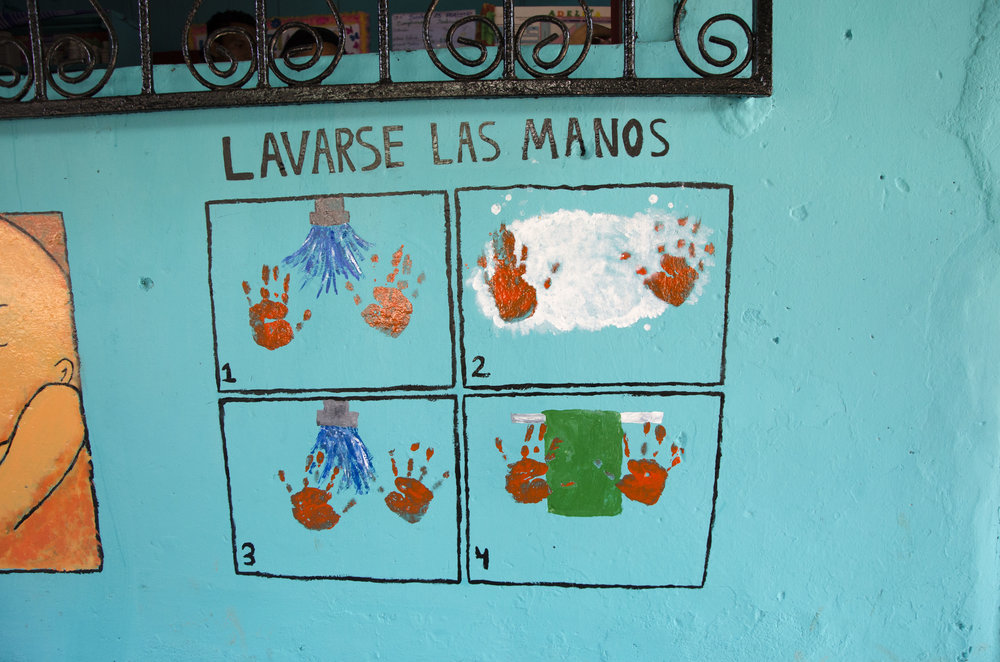 The outside of another health outpost near Adalita. This is a mural that reminds people to wash their hands in order to prevent disease.