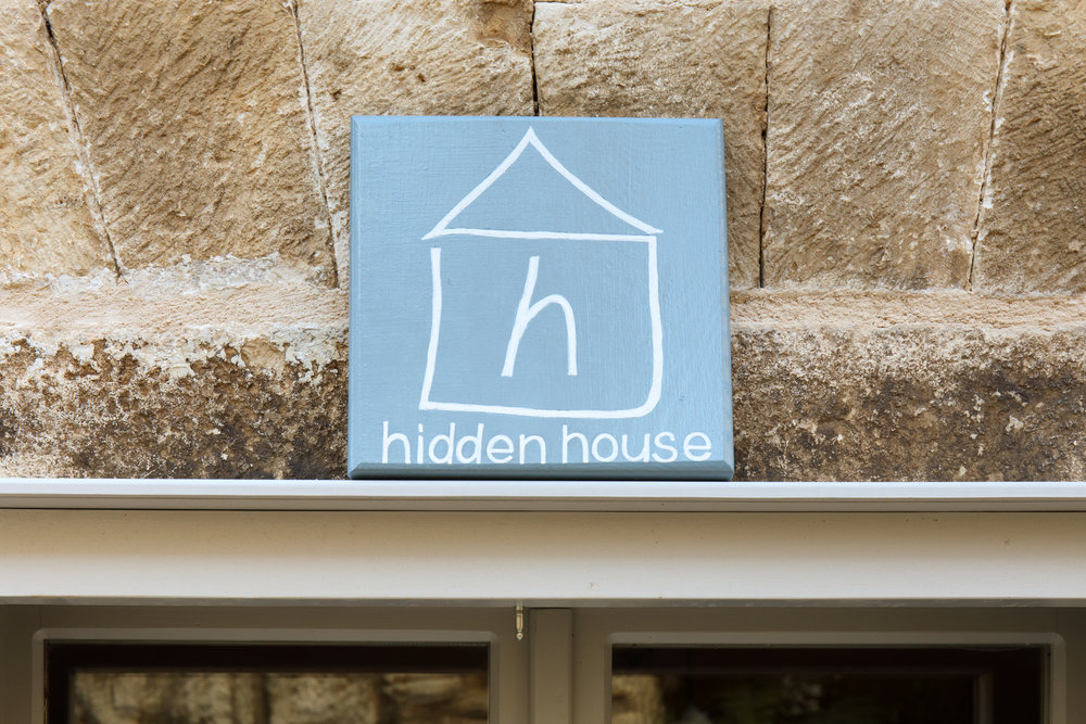 Hidden House sign  above window *.JPG