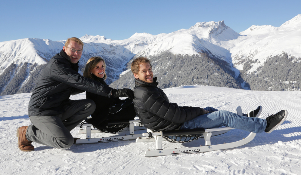Two-time F1 World Champion Mika Häkkinen, F1 test driver Susie Wolff and four-time F1 World Champion Sebastian Vettel basking under the Davos sun. (WORLD ECONOMIC FORUM/swiss-image.ch/Photo Jakob Jaegli)