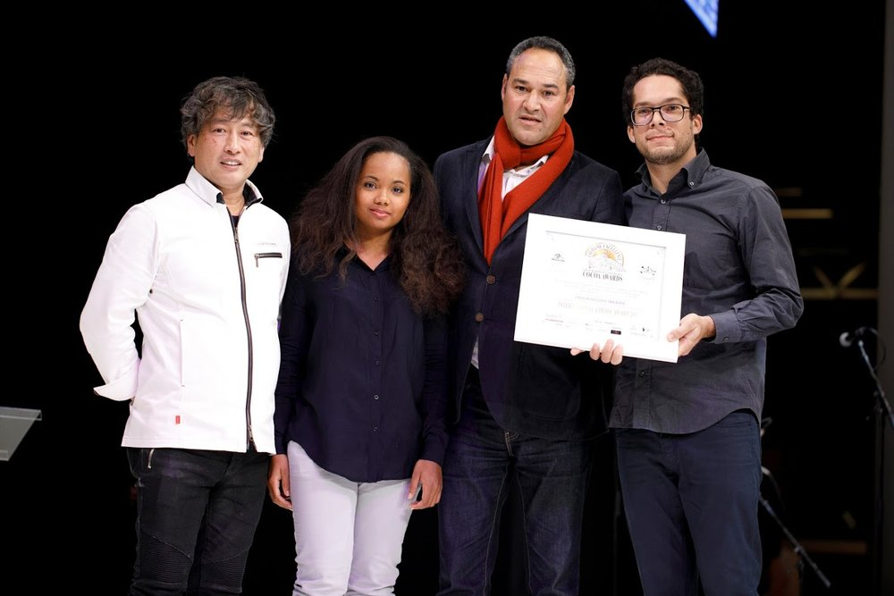 ICA winner, Central America & Caribbean: MARTINIQUE - Elizabeth Pierre-Louis & Kora Bernabe - associated to VALCACO   received the award from Japanese Chocolatier Susumu Koyama