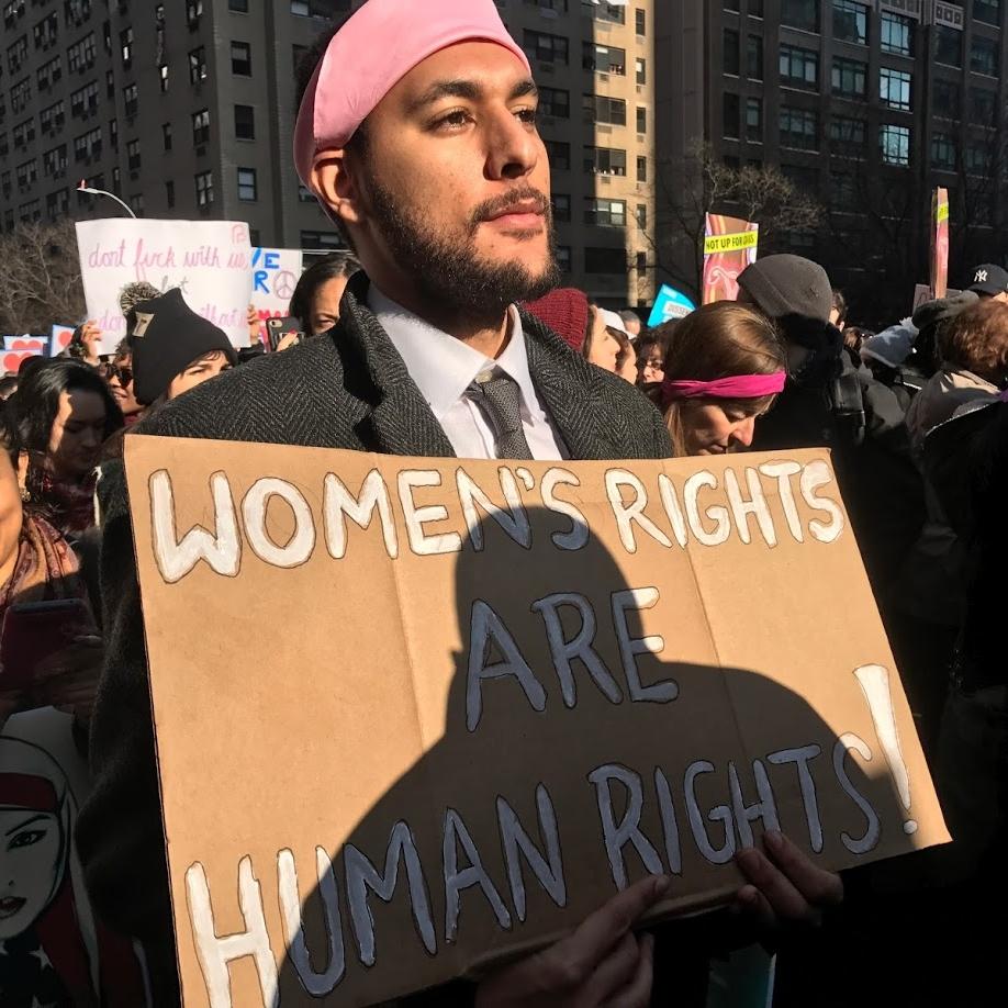 """ 'I am a woman, hear me roar!' Anti-Trump Marchers 'grab' world's attention"" The Villager"