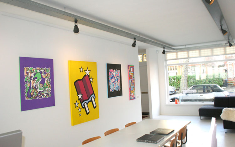 View of artworks in the Mr. Upside popup Gallery owned by Dutch urban artist Mr. Upside in Voorburg, The Netherlands