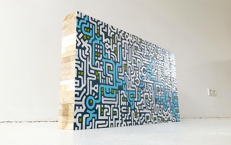Artwork Dutch contemporary artist Mr. Upside Michiel Nagtegaal wooden blocks painting KPN Teamdag 2016 give-away gift kunst cadeau in Mr. Upside Gallery full wall