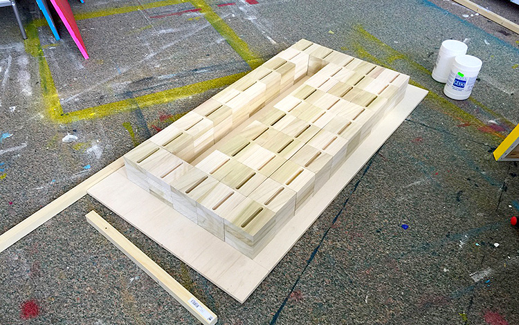 Wooden blocks with milled slot for cell phone ready for masking tape - Artwork Dutch contemporary artist Mr. Upside Michiel Nagtegaal painting KPN Teamdag 2016 give-away gift kunst cadeau in Mr. Upside Studio