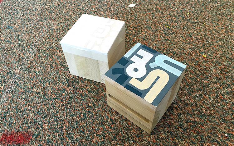 Testing the painting on the wooden blocks - Artwork Dutch contemporary artist Mr. Upside Michiel Nagtegaal painting KPN Teamdag 2016 give-away gift kunst cadeau in Mr. Upside Studio