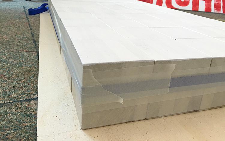 Applying the masking tape on the wooden blocks - Artwork Dutch contemporary artist Mr. Upside Michiel Nagtegaal painting KPN Teamdag 2016 give-away gift kunst cadeau in Mr. Upside Studio