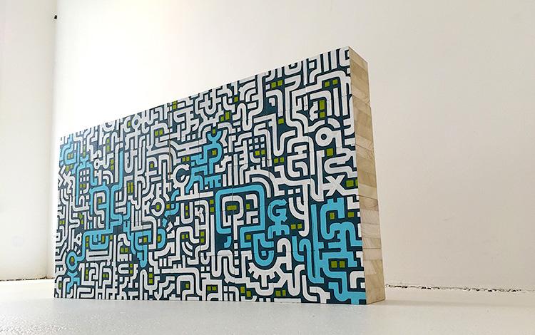 Mr. Upside Gallery Photoshoot of the painted wooden blocks - full wall of blocks - Photo 1 - Artwork Dutch contemporary artist Mr. Upside Michiel Nagtegaal painting KPN Teamdag 2016 give-away gift kunst cadeau in Mr. Upside Studio