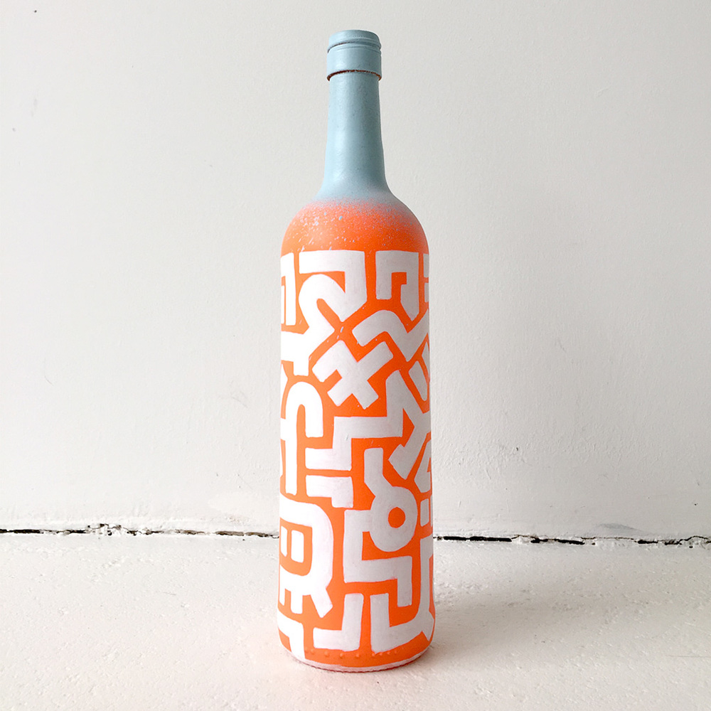 Photo 3 of Art Bottle 'Bright Orange with Light Blue and White'. The art object is a painted wine bottle by Dutch contemporary urban artist Michiel Nagtegaal / Mr. Upside.