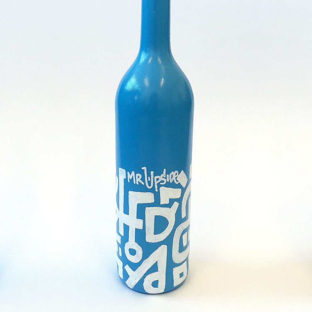 Photo 2 of Art Bottle 'Dark Blue with White 1'. The art object is a painted wine bottle by Dutch contemporary urban artist Michiel Nagtegaal / Mr. Upside.