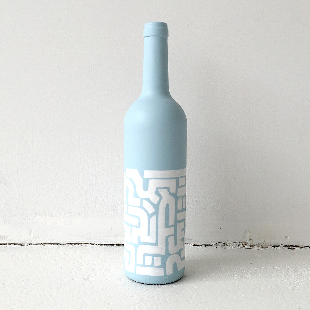 Photo 2 of Art Bottle 'Icy Blue with White 1'. The art object is a painted wine bottle by Dutch contemporary urban artist Michiel Nagtegaal / Mr. Upside.
