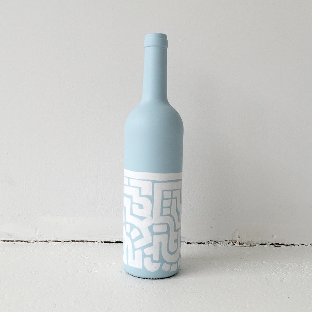 Photo 3 of Art Bottle 'Icy Blue with White 1'. The art object is a painted wine bottle by Dutch contemporary urban artist Michiel Nagtegaal / Mr. Upside.