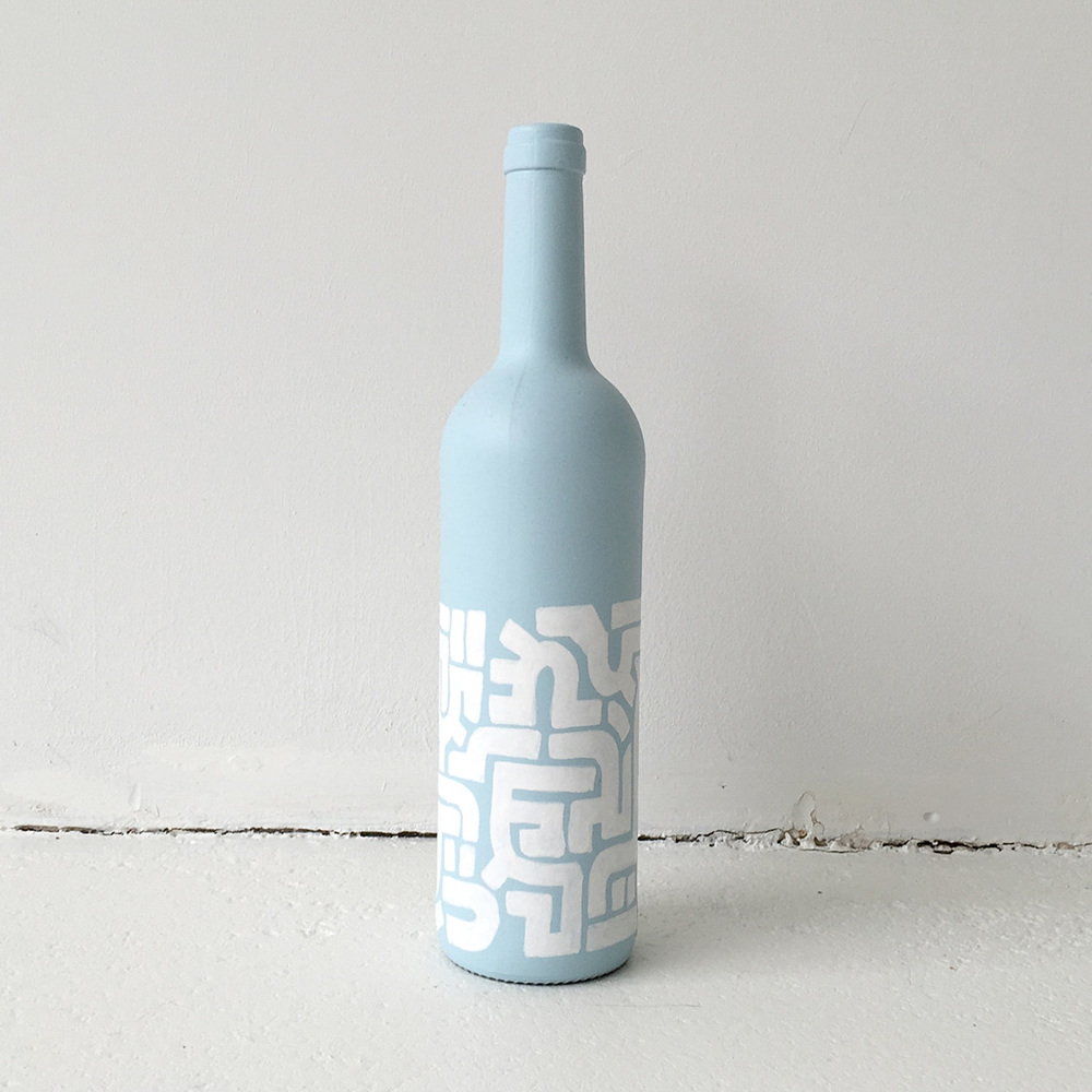 Photo 4 of Art Bottle 'Icy Blue with White 1'. The art object is a painted wine bottle by Dutch contemporary urban artist Michiel Nagtegaal / Mr. Upside.