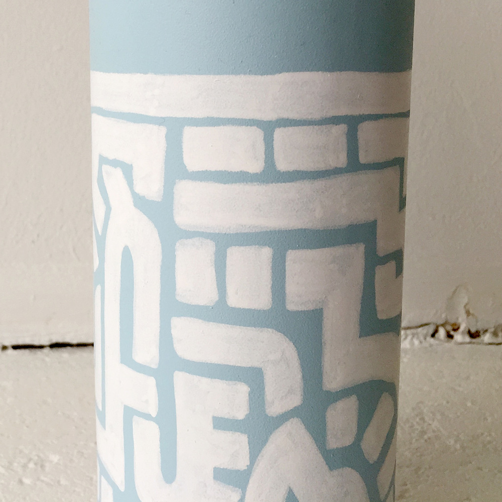 Photo 5 of Art Bottle 'Icy Blue with White 1'. The art object is a painted wine bottle by Dutch contemporary urban artist Michiel Nagtegaal / Mr. Upside.