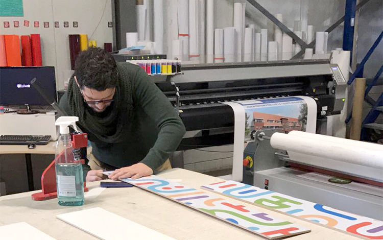A staff member of Ilioreclame, an advertising company in Lisse, The Netherlands working on one the eight risers of the demonstration stairs