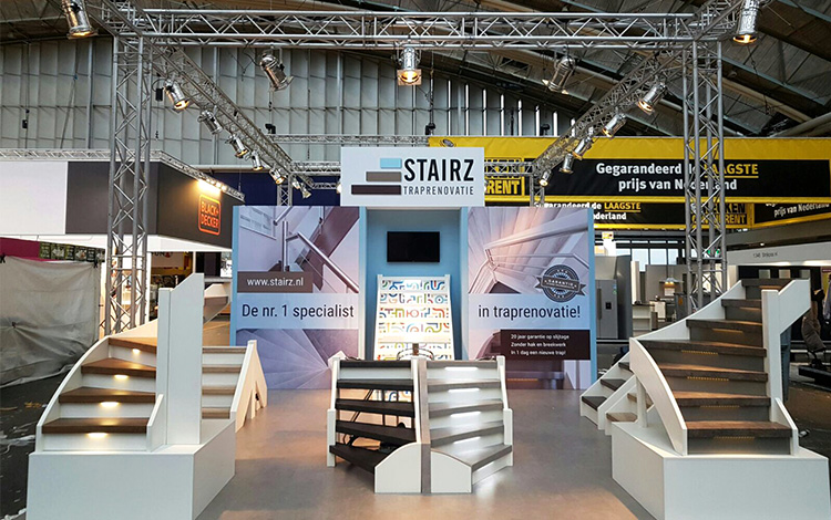 The Stairz Stairs Renovation Booth on the Huishoudbeurs 2017 in the RAI in Amsterdam, The Netherlands. In the middle of the booth are the Mr. Upside demonstration stairs