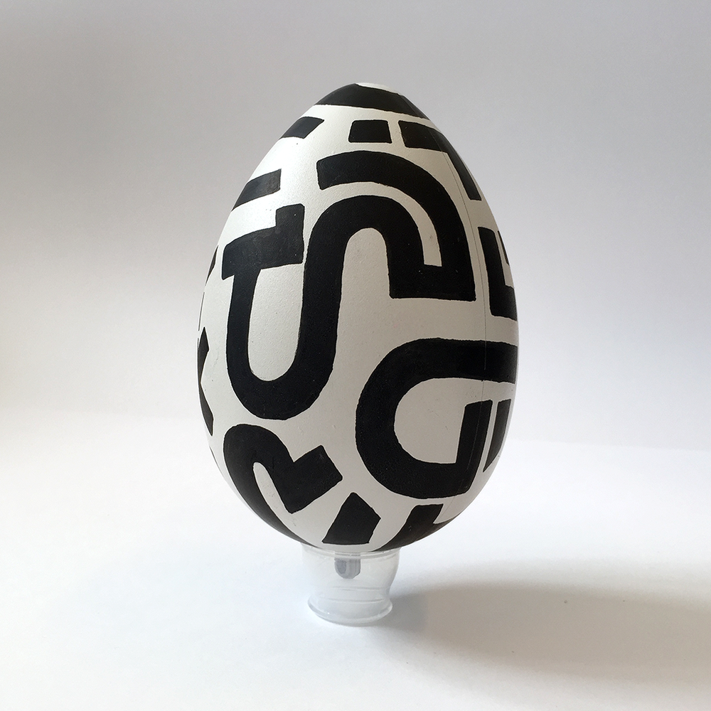 Photo 1 of Art Egg 'Black Lines 1'. The Art Egg is a painted plastic egg with black Bold Lines by Dutch contemporary urban artist Michiel Nagtegaal / Mr. Upside.