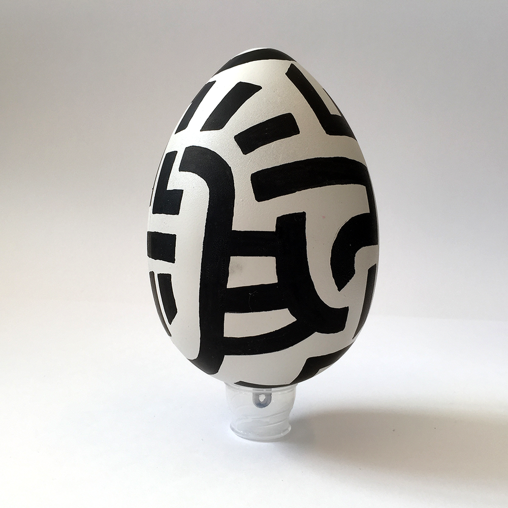 Photo 2 of Art Egg 'Black Lines 1'. The Art Egg is a painted plastic egg with black Bold Lines by Dutch contemporary urban artist Michiel Nagtegaal / Mr. Upside.