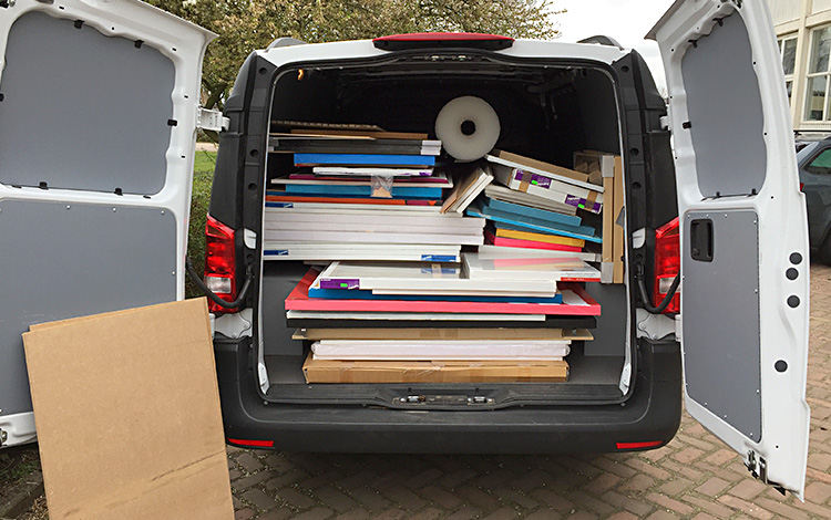 The rented van filled to the top with Mr. Upside paintings, outside building 5D of De Verlichting in the Hague, the Netherlands.