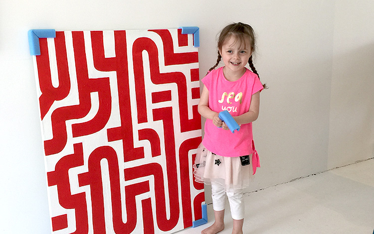 My daughter Zoë liked to help packing the painting properly. Here with painting 'Blood Lines', also available in the art webshop of Mr. Upside