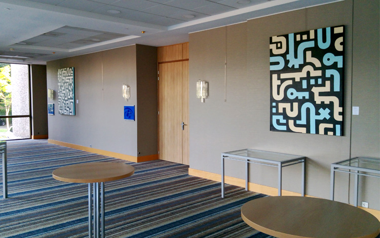 Picture 1 - Mr. Upside paintings hanging on the walls of Hilton Meetings inside Hilton Strasbourg, France. Lots of space to hang the larger artworks.