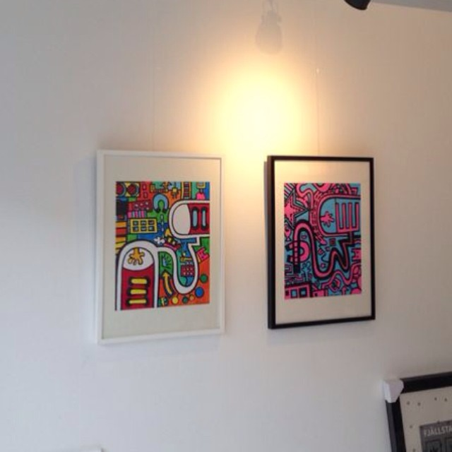 Two new artworks / illustrations hanging on our home office wall