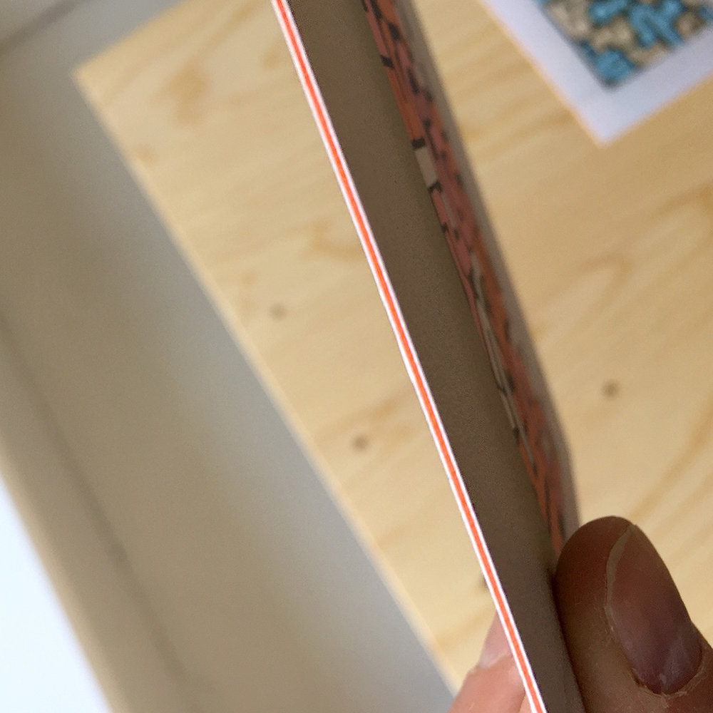 Close up view of the orange lining of the five Luxe Medium Postcards, printed on super heavy paper by Moo Cards.