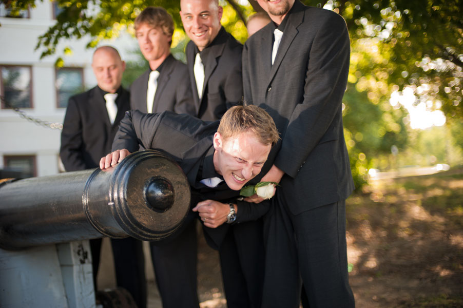 groom shot out of a canon wedding