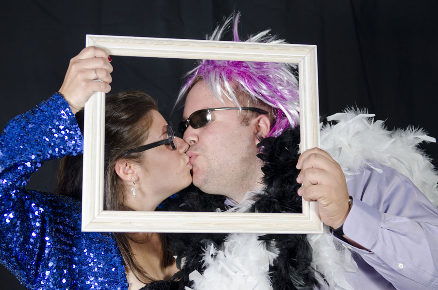 guests kissing at wedding in photobooth at Lago Bar and Grill