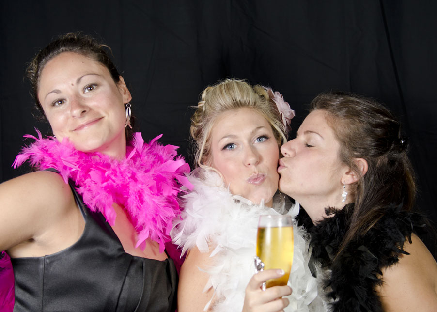 bride and guests at wedding in photobooth at Lago Bar and Grill