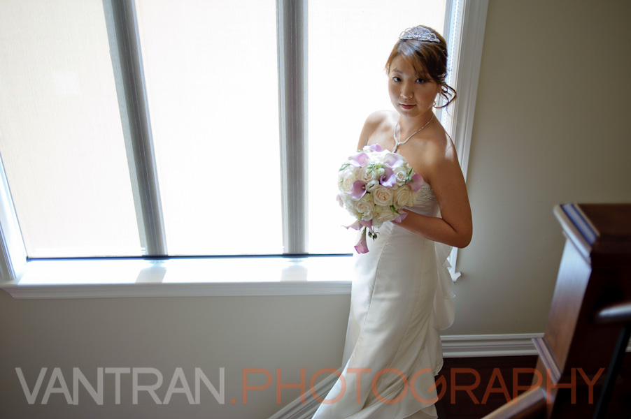 bride window light wih boquet
