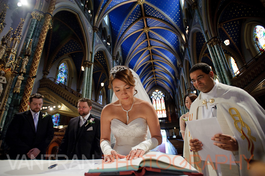 bride signing in notre-dame cathedral basilica
