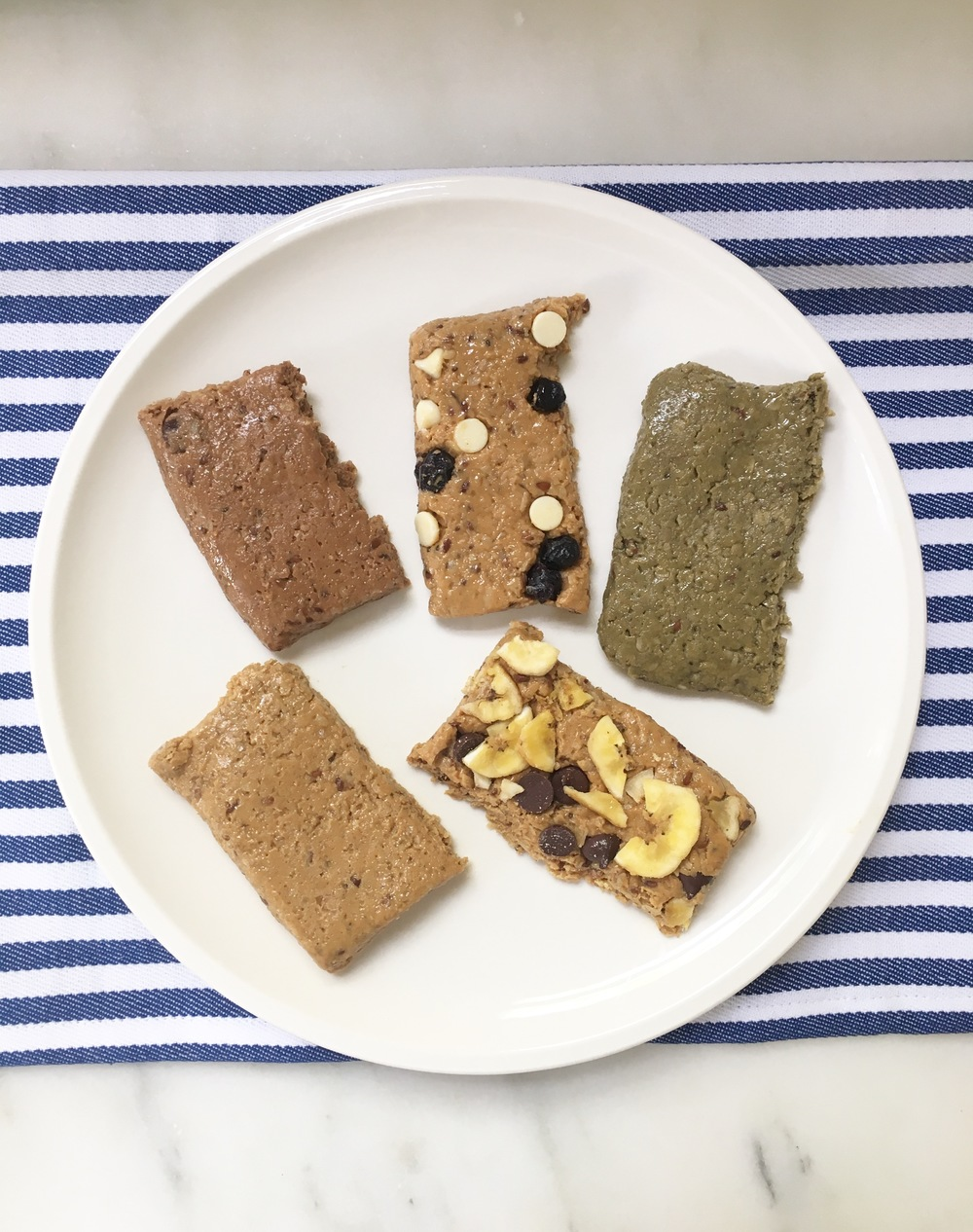Dark Chocolate, Blueberry Chip, Superfood, Banana Chip, Peanut Butter (flavors clockwise)
