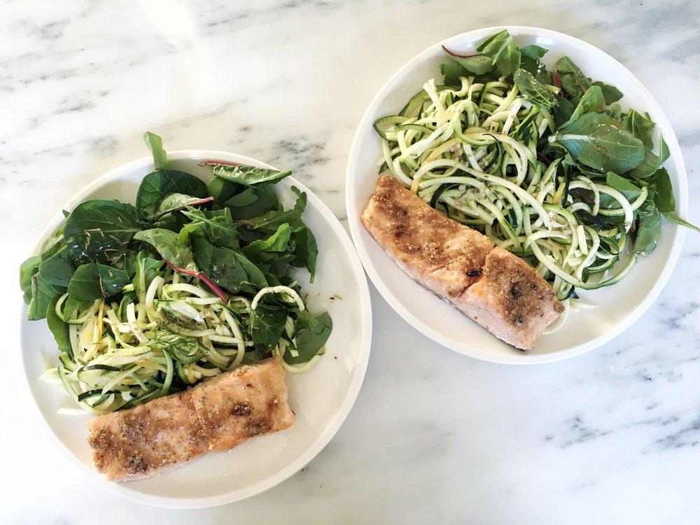 After being baked for 10 minutes at 425 degrees, the hazelnut crusted salmon goes perfectly alongside some raw greens dressed simply with olive oil, lemon and herbs.