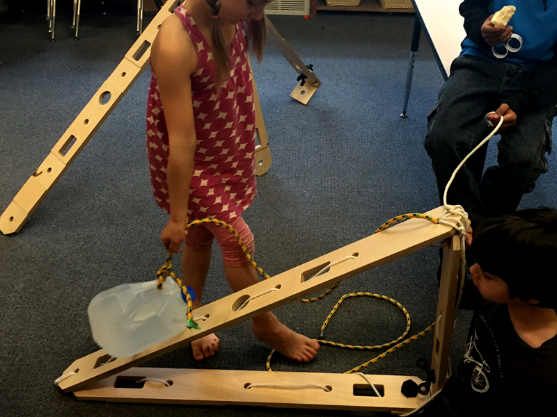 Students hand-lift jug up the ramp