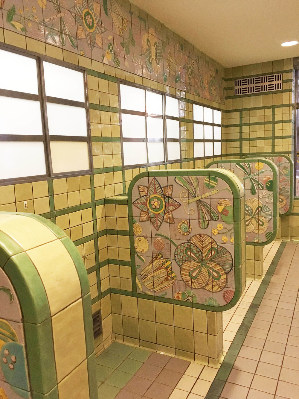 Union Terminal boasts an impressive amount of original Rookwood tile.  Most people know this as the ice cream shop, but it was originally a tea room for the passengers.  We love the bright colors and motifs in these tiles.