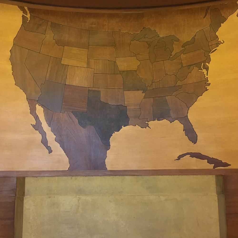A map of the United States in the President's office.  Each state was constructed from a wood indigenous to that state.