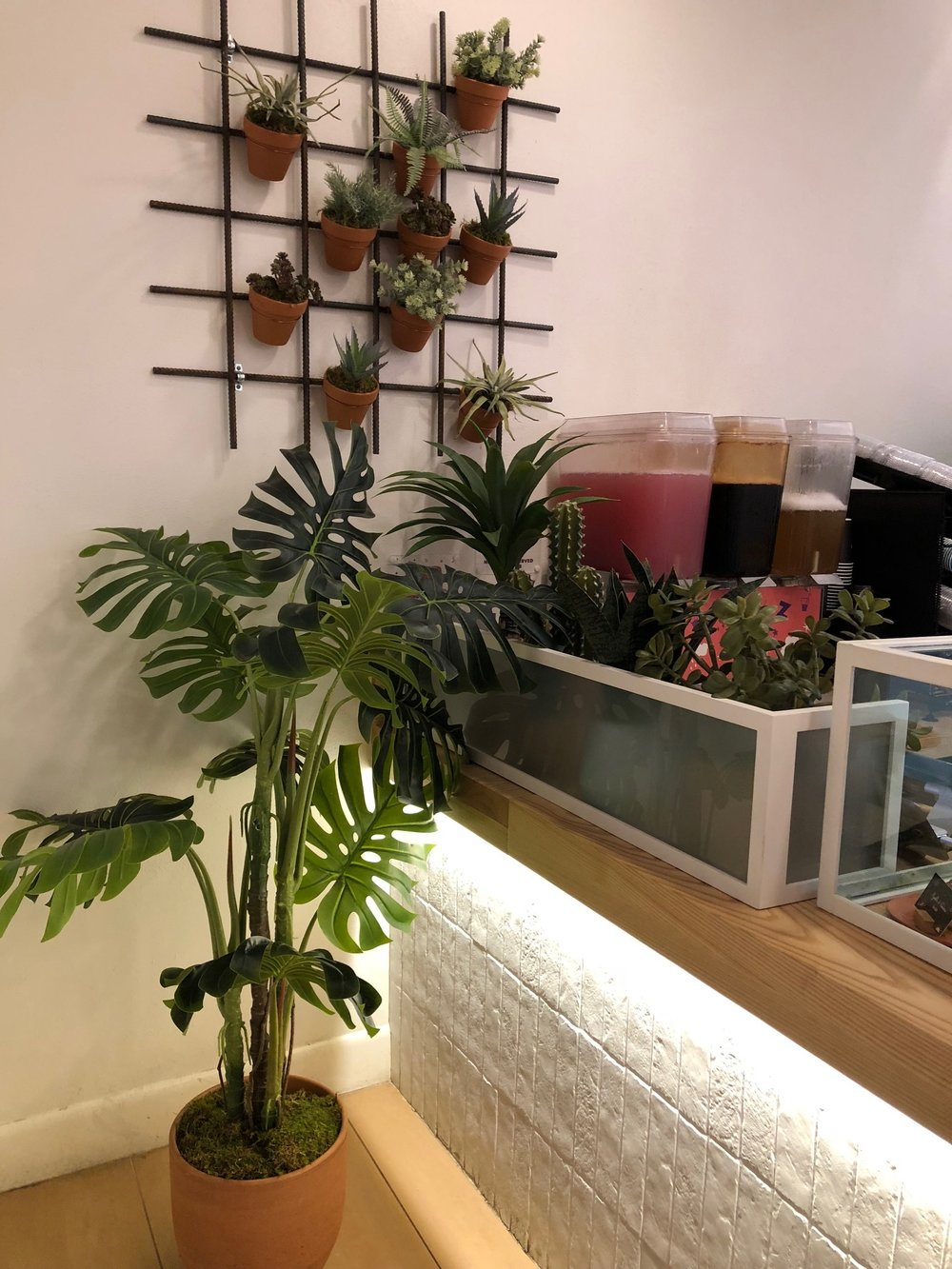 Bar area, complete with handmade-look subway tile and plenty of plants.