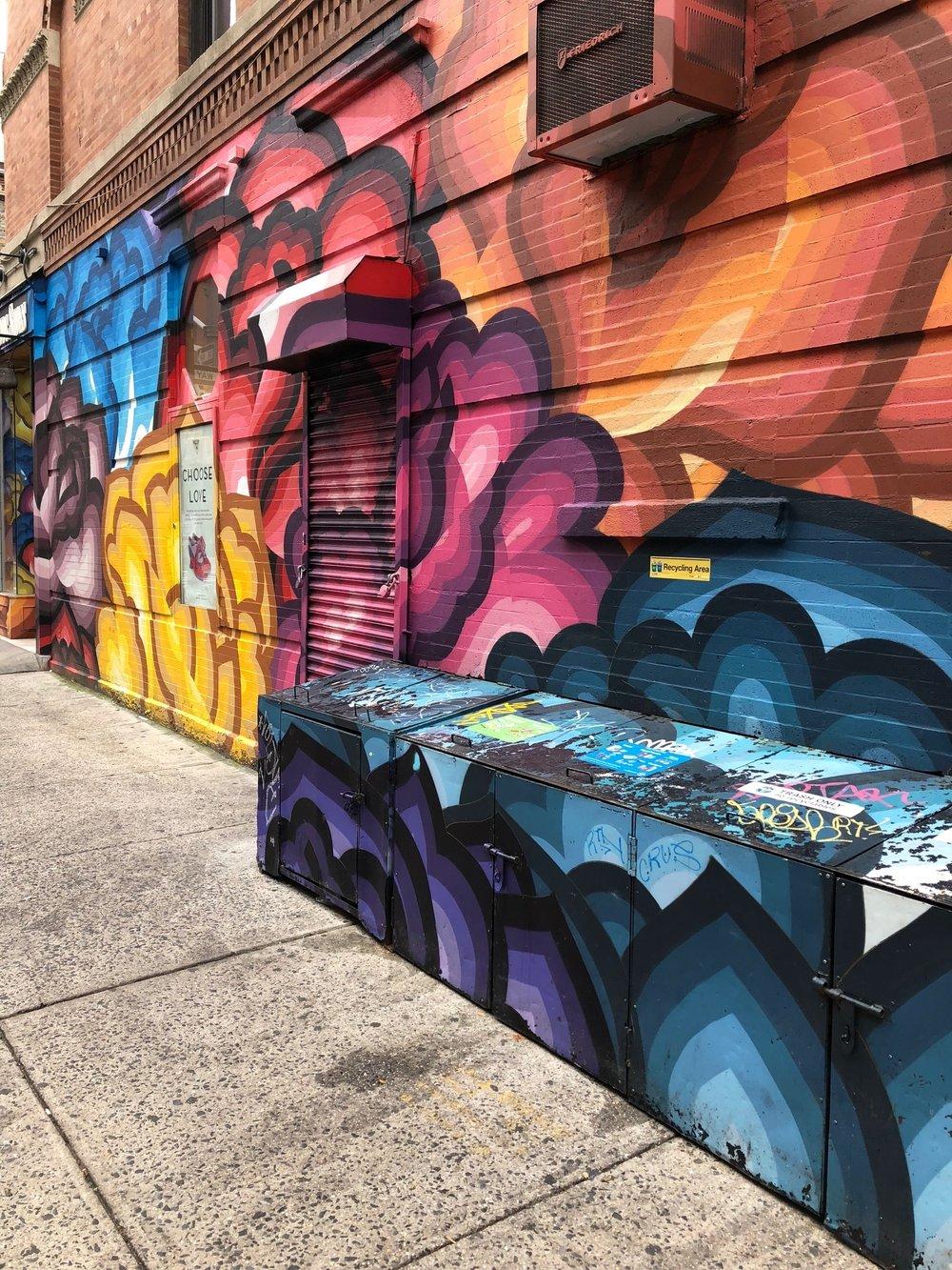 A colorful mural outside John Fluevog Shoes.