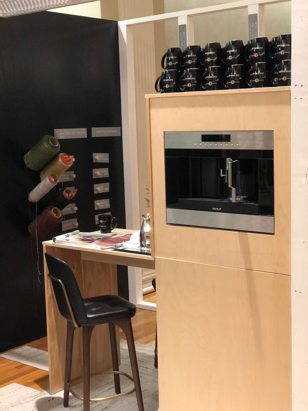 Our coffee bar, complete with custom cabinetry, the Wolf coffee maker (on loan from Custom Distributors), and counterstool from Stellar Works (on loan from Design Lab).