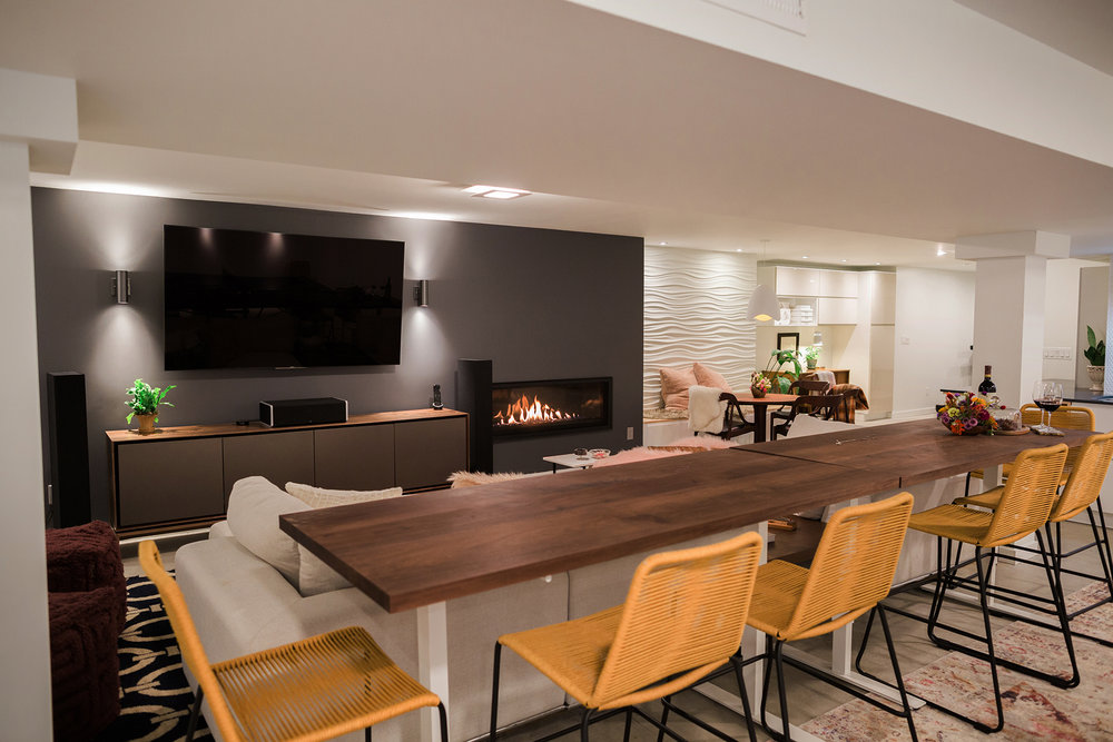 Main living area facing the tv and fireplace wall. {Photography by Olga Polo Photography}