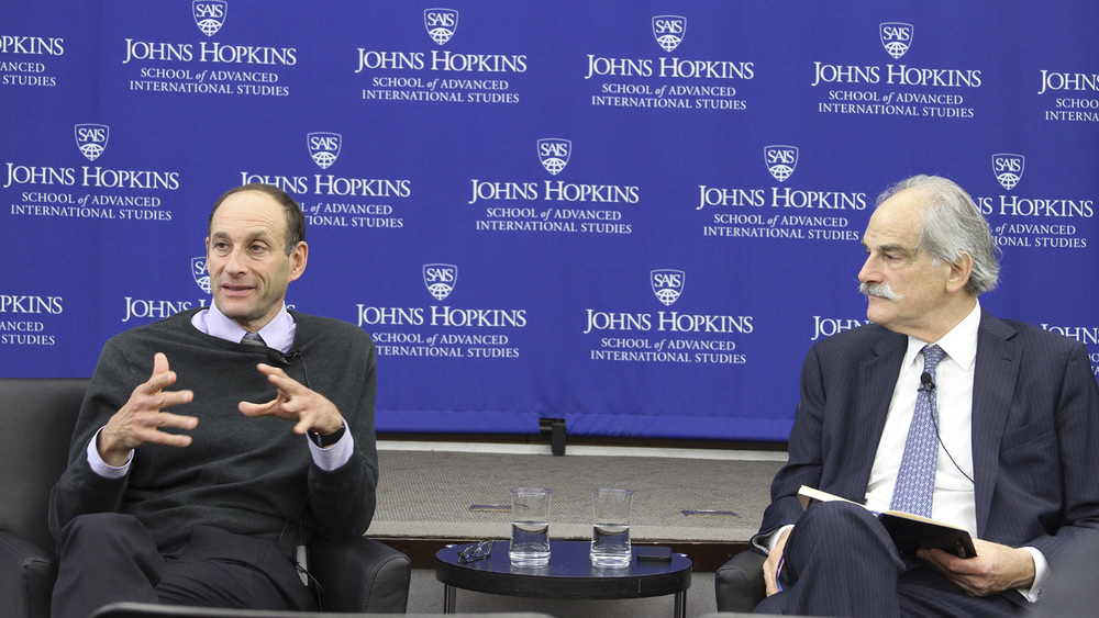 Kenneth Jacobs, left, and John Lipsky discuss global finance trends, October 1, 2015.