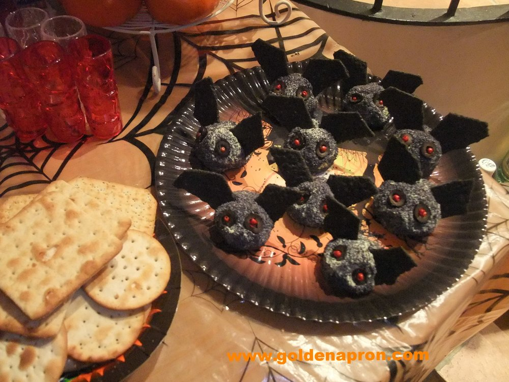 Halloween bat cheese balls poppy seeds black crackers